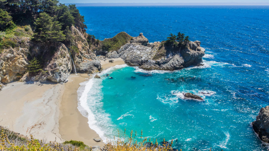 McWay Falls and the bright blue Pacific Ocean at Julia Pfeiffer Burns State Park, one of the best hikes in Big Sur, CA