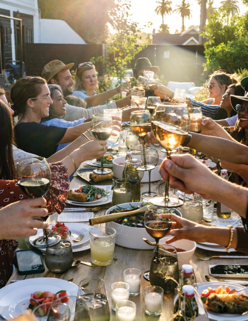 Little City Farm dinner attendees toasting wine glasses