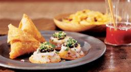 potato chutney crisps served with somosas