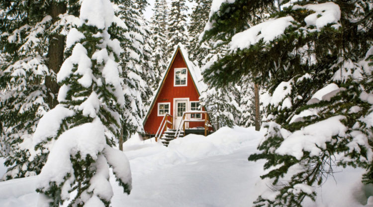 Red cozy cabin in the snow at Alpine Lakes High Camp