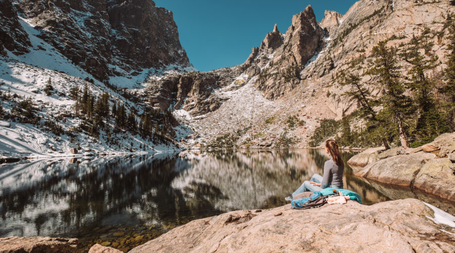 Woman near Emerald Lake at autumn in Rocky Mountain National Park in Colorado.