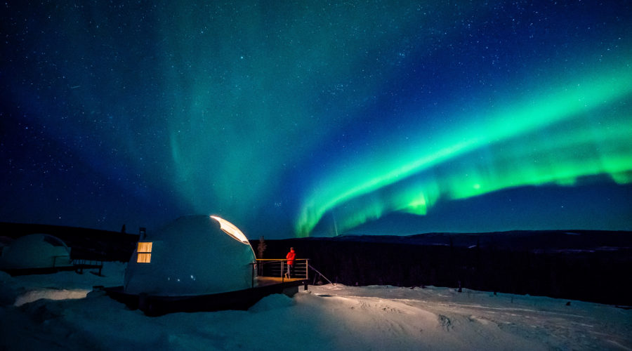 The Northern Lights as seen from Borealis Basecamp in Fairbanks, one of the best affordable thanksgiving getaways in the West