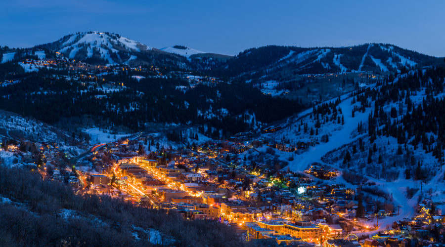 Dusk View of Park City Glowing during affordable thanksgiving getaways