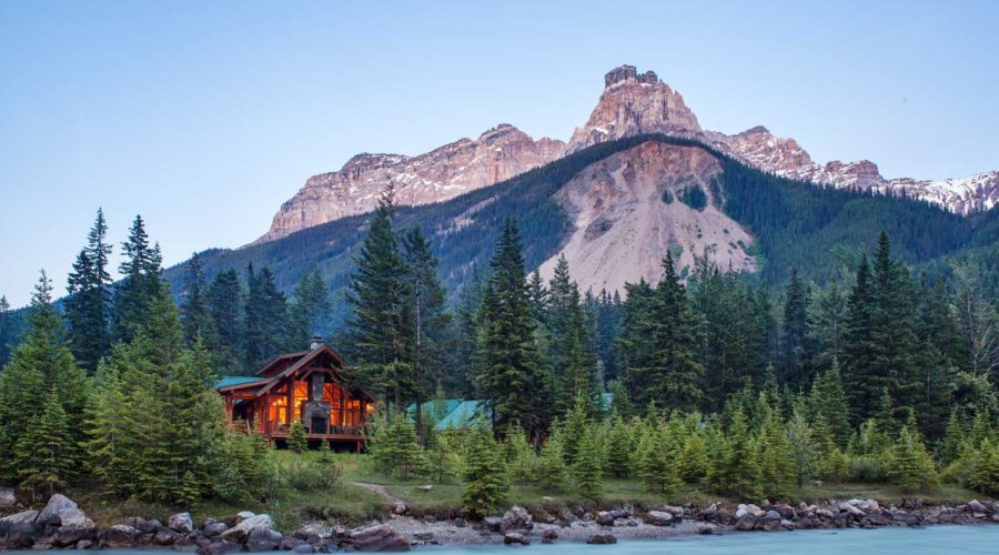 Cathedral Mountain Lodge's cozy cabins set against the mountains of B.C.