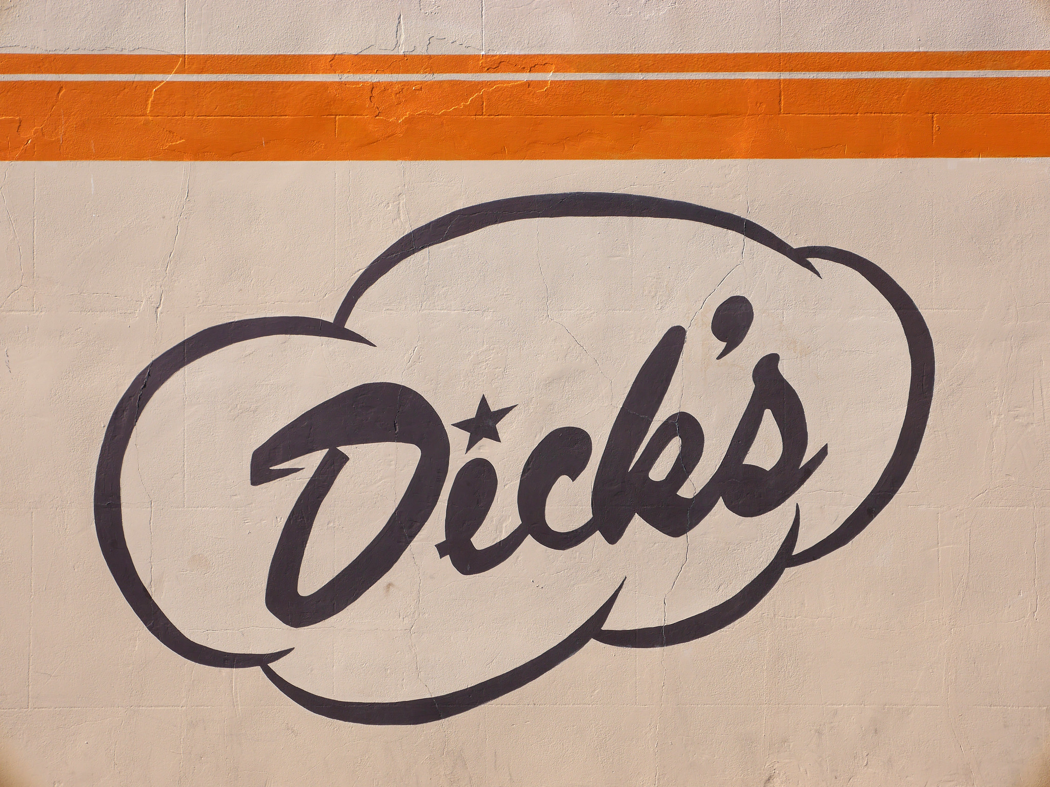 Dick's Drive-in logo on restaurant wall