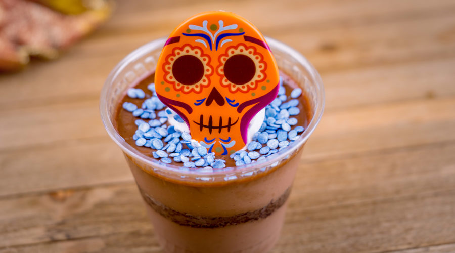 A cup of chocolate pudding with a sugar skull deocration