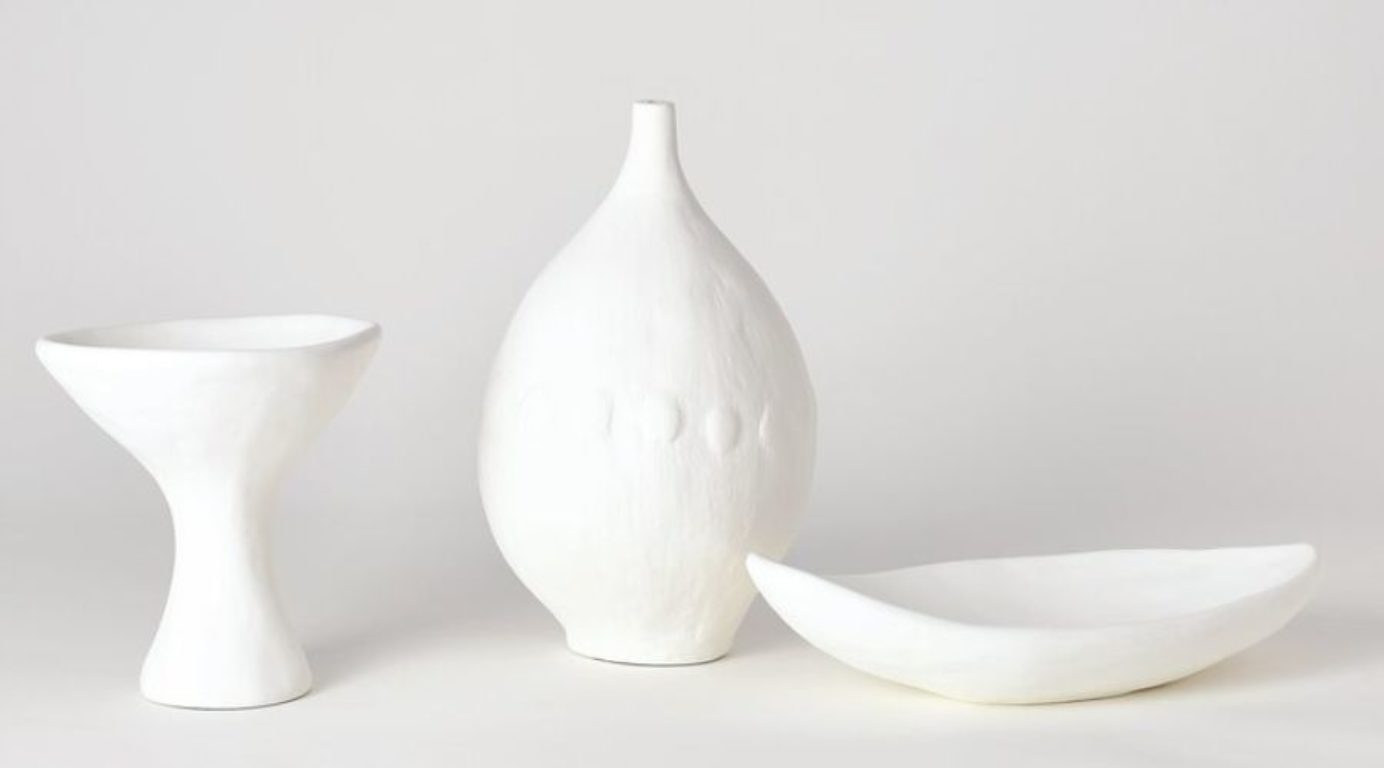 Perigold Plaster table vase shown with decorative bowl and cup