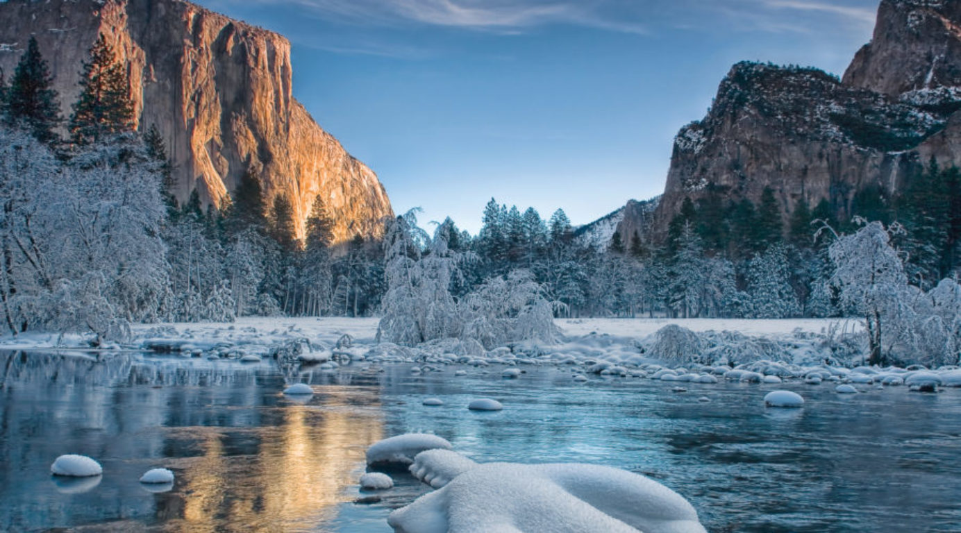 A sunrise over the Yosemite Valley floor coated with rime ice
